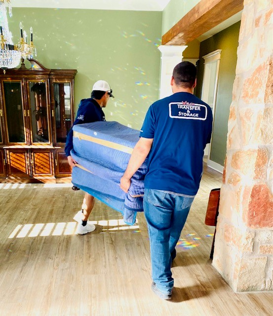 Two men moving a blue furniture